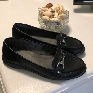 Black flats with silver buckle